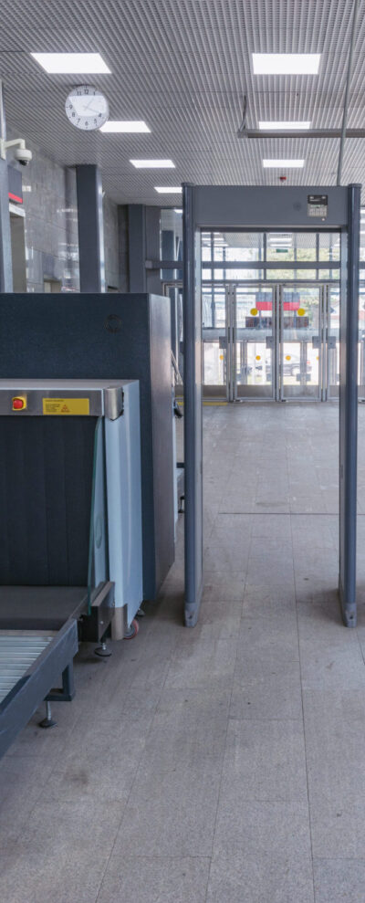 Security checkpoint in the railway station corridor.